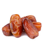 Dried Dates in close up. Dried dates isolated on white background Stock Images