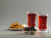 Dried dates and figs, karkade tea in armudu glasses royalty free stock image