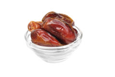 Dried dates on glass bowl Royalty Free Stock Photo