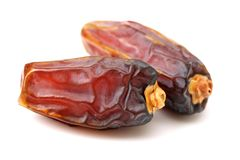 Dried dates. Isolated on a white background Royalty Free Stock Photos