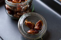 Dried dates in a jar, black background Royalty Free Stock Photos