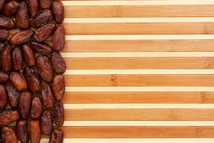 Dried dates lying on a bamboo mat Royalty Free Stock Photos