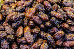 Dried dates on the market close up. Dried dates on the market background texture close up Stock Images