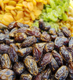 Dried Dates At Market. A mound of dried dates and other fruit displayed at a market stand in the Old City of Jerusalem in Israel Royalty Free Stock Image