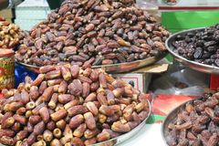 Dried dates at a market. A rich selection of different varieties of dates on the Dubai market Stock Image