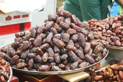 Dried dates at a market. A rich selection of different varieties of dates on the Dubai market Stock Images