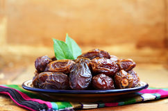 Dried dates on oriental ceramic plate Royalty Free Stock Photography