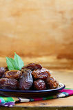 Dried dates on oriental ceramic plate Stock Photography