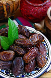 Dried dates in oriental style Stock Images