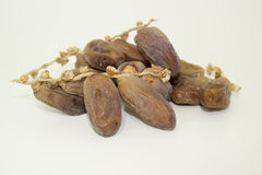 Dried dates. A pile of drieddates with branches Stock Images