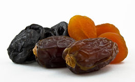 Dried dates, prunes and apricots on white background Stock Photography