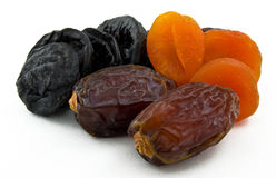 Dried dates, prunes and apricots on white background Royalty Free Stock Photography