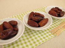 Dried dates in small bowls Stock Photo