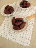 Dried dates in small bowls Stock Image