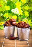 Dried dates in tin pail Stock Image