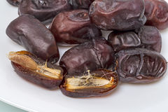 Dried dates (tropical fruit)  on white Royalty Free Stock Photos