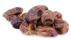 Dried dates on a white background stock photo