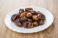 Dried dates in white glass on table Royalty Free Stock Photos