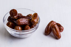 Dried dates on white table Stock Image
