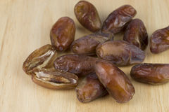 Dried dates on the wood table Stock Photography