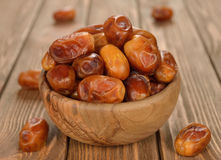 Dried dates. In a wooden bowl Stock Photos