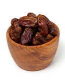Dried dates in wooden bowl isolated on white Royalty Free Stock Photography