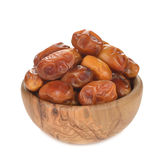Dried dates in a wooden bowl Stock Images