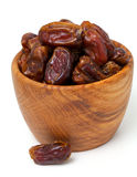 Dried dates in a wooden bowl Royalty Free Stock Photography