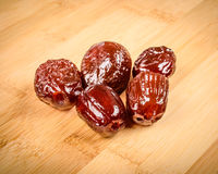 Dried dates. On a wooden cutting board Royalty Free Stock Image