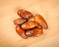 Dried dates. On a wooden cutting board Stock Photography