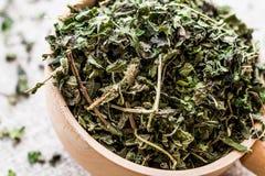 Dried Dead Nettle / isirgan otu or urtica urens in wooden ladle stock images