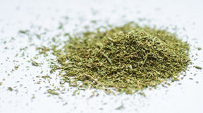 Dried, dill, grass, green, dry, small, heap, flavor, seasoning. Crushed dried dill seasoning for food royalty free stock photo