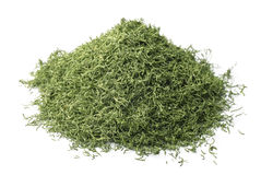 Dried dill. Pile of dried dill isolated on white Royalty Free Stock Photography