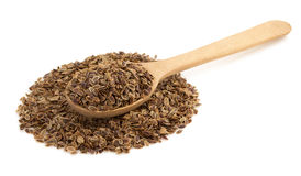 Dried dill seeds in spoon on white Royalty Free Stock Photo