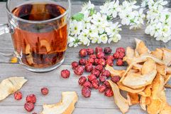 Dried dog rose, rosehips, apples and tea Royalty Free Stock Photography