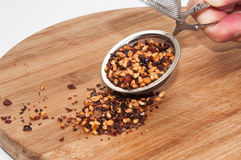 DRIED DOG ROSE WITH TEA STRAINER AND SPOON Stock Photo