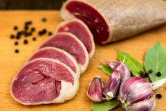 Dried duck meat. Sliced on the board with black pepper and garilc Royalty Free Stock Photography