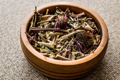 Dried Echinacea Purpurea Root in wooden bowl.