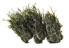 Dried edible seaweed. On a white background Royalty Free Stock Photo