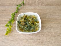 Dried european goldenrod in bowl. Solidago virgaurea Royalty Free Stock Images