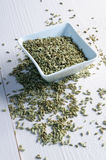 Dried fennel seeds. In a bowl, on a bright wood Stock Photography