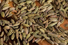 Dried Fennel seeds on a wood chopping board Royalty Free Stock Photography