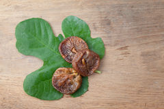 Dried fig on wooden table Stock Image