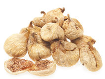 Dried figs. A handful of dried figs. On a white background stock images