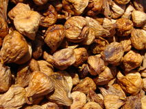 Dried figs. Brown dried figs on sun macro photo Royalty Free Stock Image