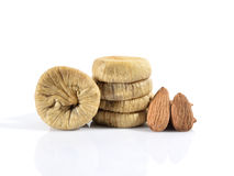 Dried figs and almonts. Dried figs and almonds isolated on white background Royalty Free Stock Images