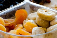 Dried figs and apricots in glass transparent bowl Stock Photos