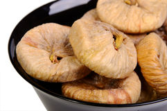 Dried figs in black plate Stock Images
