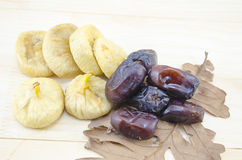 Dried figs and date palms on a wooden table Stock Image