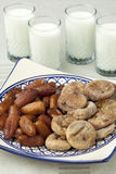 Dried figs and dates with milk Royalty Free Stock Image